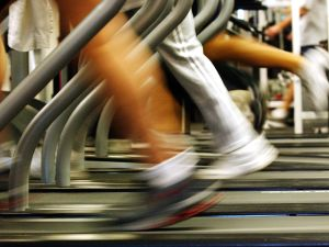 People run on treadmills at a New York Sports Club in Brooklyn.