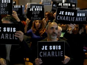 "Members of the French Jewish community hold signs reading in French ""I am Charlie"" during rally in Jerusalem on January 11, 2015, to demonstrate Jerusalem's support for France and the Jewish community and to protest against the attack on the French satirical magazine Charlie Hebdo's office in Paris which killed 12 people and the attack on a kosher supermarket. Four of the fatalities in France's three-day wave of violence were Jews killed in an attack on a kosher supermarket hours before the start of the Jewish Sabbath on Friday. AFP PHOTO/ GALI TIBBON (Photo credit should read GALI TIBBON/AFP/Getty Images)"