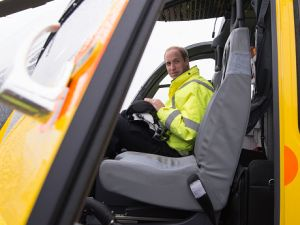 CAMBRIDGE , UNITED KINGDOM - JULY 13: Prince William, The Duke of Cambridge sits in the cockpit of an helicopter as he begins his new job with the East Anglian Air Ambulance (EAAA) at Cambridge Airport on July 13, 2015 in Cambridge, England. The former RAF search and rescue helicopter pilot will work as a co-pilot transporting patients to hospital from emergencies ranging from road accidents to heart attacks. (Photo by Stefan Rousseau WPA - Pool/Getty Images)