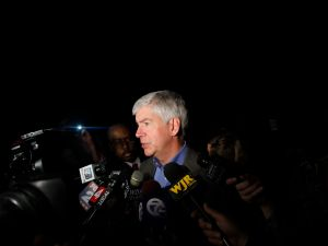 DETROIT, MI - MAY 21: Michigan Governor Rick Snyder speaks speaks to reporters after a luncheon May 21, 2014 in Detroit, Michigan. JP Morgan Chase CEO Jamie Dimon announced during the luncheon that JP Morgan Chase will invest $100-million to help the city of Detroit with blight removal, urban development, home loans and retraining people in the work force. (Photo by Joshua Lott/Getty Images)