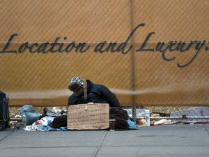 A homeless man looking for money for a room sits on Fifth Avenue near 42nd Street in New York January 4, 2016. (Photo: TIMOTHY A. CLARY/AFP/Getty Images)