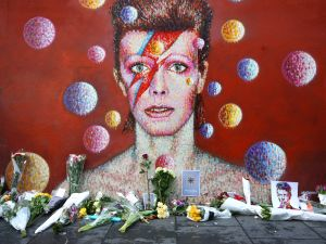 7. David Bowie David Bowie was another music legend lost in 2016. In this photo, flowers are laid beneath a mural of him.