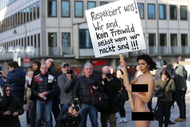 Performance Artist Stands Nude in Germany To Protest Wave of Attacks on Women
