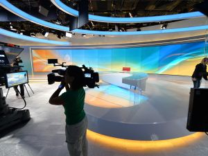 A television camerawoman takes video of the new Al Jazeera America television broadcast studio on West 34th Street August 16, 2013 in New York. Al Jazeera America, which will launch on August 20, will have its headquarters in New York. AFP PHOTO/Stan HONDA (Photo credit should read STAN HONDA/AFP/Getty Images)
