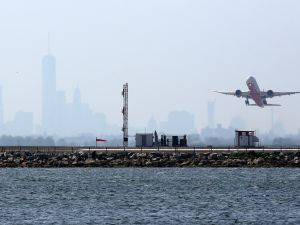 An aircraft takes off from New York's John F. Kennedy Airport (TREVOR COLLENS/AFP/Getty Images).