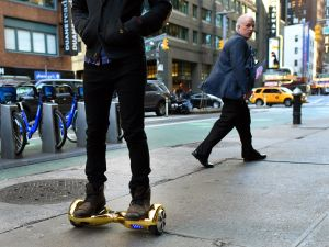 "Whizboard Store manager 'Mor Loud' demonstrates the Hoverboard on Broadway in Times Square in New York on December 15, 2015. The hot item on many holiday lists will help you zip around town, the shopping mall and from one end of the workplace to another.These so-called ""hoverboards"" or self-balancing electric scooters, are surging in popularity in the first season where they have been available at relatively affordable prices -- as low as $300 for some models. AFP PHOTO / TIMOTHY A. CLARY / AFP / TIMOTHY A. CLARY (Photo: Timothy A. Clary/Getty Images)"
