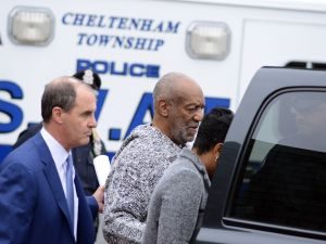 ELKINS PARK, PA - DECEMBER 30: Bill Cosby is led from the Cheltenham Police Station after his arraignment at Montgomery County District Court on sexual assault charges December 30, 2015 in Elkins Park, Pennsylvania. Cosby was arraigned at 2:30 p.m. before Magisterial District Judge Elizabeth McHugh charged with Aggravated Indecent Assault. Bail was set at $1 million under the condition that he surrender his passport and have no contact with the victim. Cosby was released after posting the required 10 percent of the bail, $100,000. (Photo by William Thomas Cain/Getty Images)