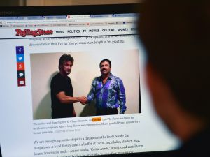 """A man reads an article about drug lord Joaquin Guzman, aka """"El Chapo"""", showing a picture of him (R) and US actor Sean Penn, on the website of Rolling Stone magazine, in Mexico City, on January 10, 2016. The Hollywood-worthy recapture of """"El Chapo"""" took a stunning turn Sunday as authorities sought to question Penn over his interview with the Mexican drug kingpin. A federal official told AFP that the attorney general's office wants to talk with Penn and Mexican actress Kate del Castillo about their secretive meeting with Guzman in October, three months before his capture on January 8. AFP PHOTO / ALFREDO ESTRELLA / AFP / ALFREDO ESTRELLA (Photo credit should read ALFREDO ESTRELLA/AFP/Getty Images)"""
