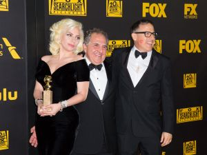 BEVERLY HILLS, CA - JANUARY 10: 10: (L-R) Actress/singer Lady Gaga, winner of Best Performance in a Miniseries or Television Film for 'American Horror Story: Hotel,' Fox Filmed Entertainment Chairman/CEO Jim Gianopulos, and director David O. Russell attend Fox And FX's 2016 Golden Globe Awards Party on January 10, 2016 in Beverly Hills, California. (Photo by Alison Buck/Getty Images)