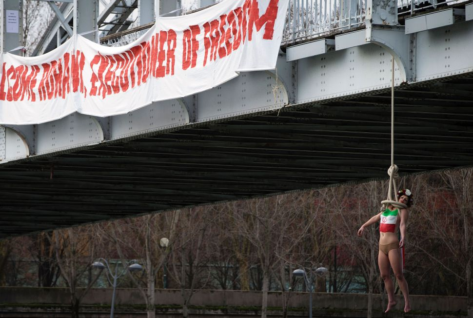 Topless Woman Stages Paris Hanging in Protest of Iranian President