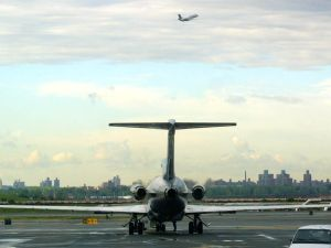 NEW YORK, UNITED STATES: An airplane readies to taxi while another takes off at LaGuardia Airport in New York 14 September 2001. The airport reopened 14 September 2001 three days after the terrorist attacks on US soil. AFP PHOTO/Doug KANTER (Photo credit should read DOUG KANTER/AFP/Getty Images)