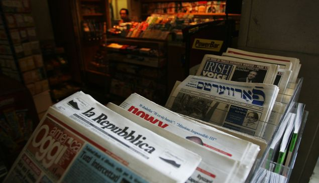 Newspapers in dozens of languages are offered at the newstand of the United Nations. (Photo by Chris Hondros/Getty Images)