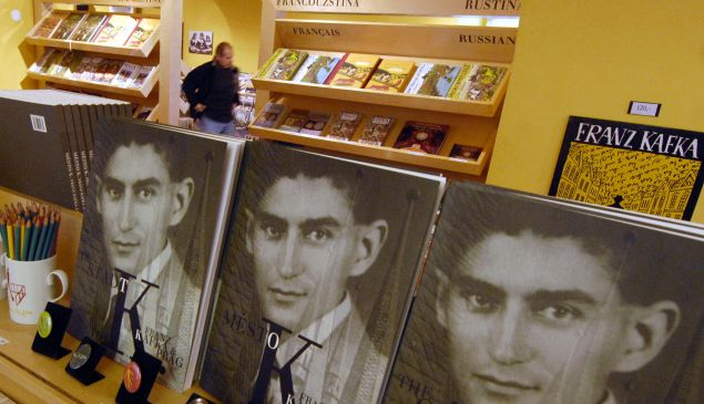 "TO GO WITH AFP STORY BY JAN MARCHAL-Czech-literature-history-Kafka- Recent picture of books of Czech writer Franz Kafka are on display at a tourist boutique, 19 October 2007 in Prague. Franz Kafka (1883-1924), born into a middle class Prague Jewish family is an author of ""The Trail"", ""The Castle"" and ""The Metamorphosis"". Kafka is regarded as one of the most important German language novelists and short story writers of the 20th century. Banned by the Nazis, shunned by the communists, and regarded as a stranger by the citizens of his home city, Prague-born German-language author Franz Kafka will have his completed works published for the first time in Czech. AFP PHOTO MICHAL CIZEK"
