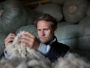 Matt Scanlon inspects cashmere threads (Photo: Courtesy Naadam).