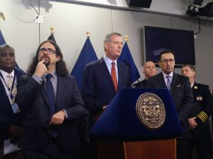Mayor Bill de Blasio updates New Yorkers on an impending blizzard, with help from a sign language interpreter, at the Office of Emergency Management. (Photo: Jillian Jorgensen for Observer)