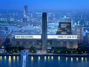 The new Tate Modern seen rising behind the museum's iconic Turbine Hall. (Photo: Tate)