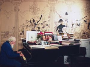 Al Hirschfeld photographed by Jill Krementz on December 4th, 1971, playing the piano in his living room. The house features a large section of Hirschfeld-designed wallpaper. (Photo: © Jill Krementz)