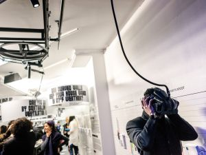 """A guest at the opening of """"Closed Worlds,"""" experiencing Farzin Farzin's virtual reality work, Some World Games."""