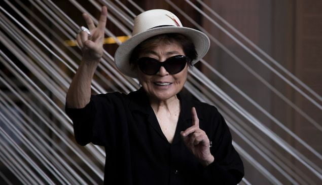 """Artist Yoko Ono poses for pictures during the opening of """"Yoko Ono: Land of Hope"""" at the Museo Memoria y Tolerance in February in Mexico City."""