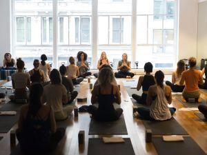 Tegan Bukowski, Jordan Daly, Millana Snow lead a yoga class at SereneHouse (Photo: BFA).