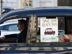 An Uber driver protests in London.