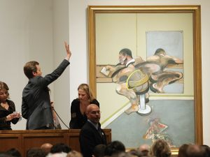 "NEW YORK, NY - MAY 09: Francis Bacon's 'Figure Writing Reflected in Mirror"" is auctioned at Sotheby's on May 9, 2012 in New York City. The market for contemporary art has been on fire in recent months with Edvard Munch's ""The Scream"" posting an auction record of $119 million at Sotheby's on May 2. (Photo by Mario Tama/Getty Images)"