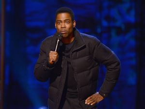 Chris Rock performs on stage at Comedy Central Night Of Too Many Stars at Beacon Theatre on February 28, 2015 in New York City.