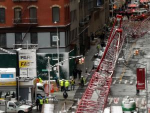 NEW YORK, NY - FEBRUARY 05: Emergency workers converge at the scene of a collapsed crane in a roadway in lower Manhattan Friday morning on February 5, 2016 in New York City. The accident killed at least one person and seriously injured two according to the New York City Fire Department. (Photo by Spencer Platt/Getty Images)