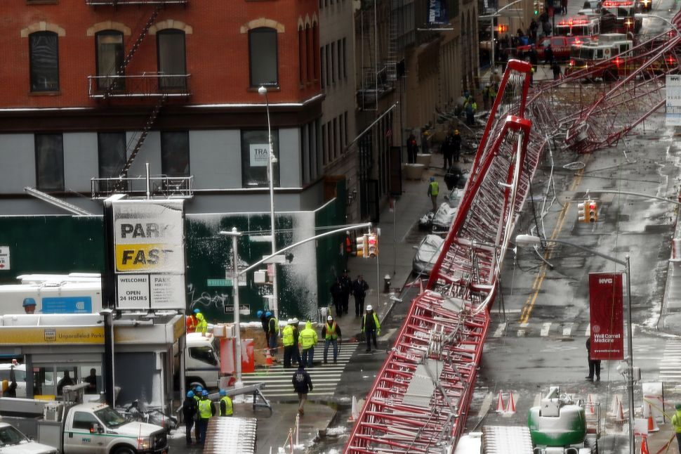 Afternoon Bulletin: Manhattan Crane Collapse, Officers Shot in the Bronx and More