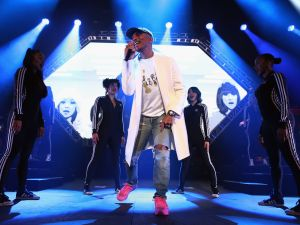 Pharrell performs in a pair of ripped jeans (Photo: Christopher Polk/Getty Images for Pepsi).
