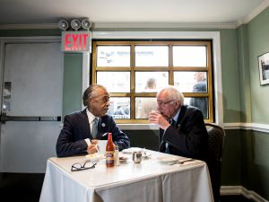 Democratic presidential candidate Sen. Bernie Sanders meets with Reverend Al Sharpton at Sylvia's Restaurant. (Photo by Andrew Renneisen/Getty Images)