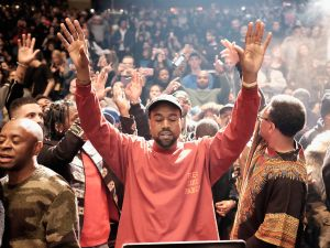 Kanye West, having a spiritual experience via his laptop.