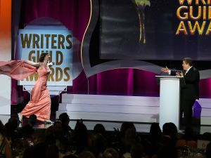 Kristen Schaal runs to West Coast host Patton Oswalt during the 2016 Writers Guild Awards.