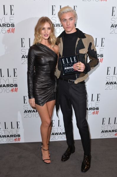 Rosie Huntington-Whiteley in Roberto Cavalli and Lucky Blue Smith in Tom Ford