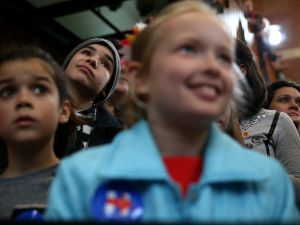 "Young supporters look on as democratic presidential candidate former Secretary of State Hillary Clinton speaks during a ""Get Out The Vote"" rally at the Lyman & Merrie Wood Museum of Springfield History on February 29, 2016 in Springfield, Massachusetts. Hillary Clinton is campaigning in Massachusetts and Virginia ahead of Super Tuesday."