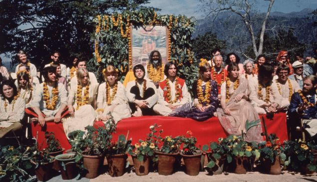 Caption:The Beatles and their wives at the Rishikesh in India with the Maharishi Mahesh Yogi, March 1968. The group includes Ringo Starr, Maureen Starkey, Jane Asher, Paul McCartney, George Harrison (1943 - 2001), Patti Boyd, Cynthia Lennon, John Lennon (1940 - 1980), Beatles roadie Mal Evans, Prudence Farrow, Jenny Boyd and Beach Boy Mike Love. (