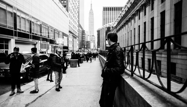 A male model musing outside of NYFW