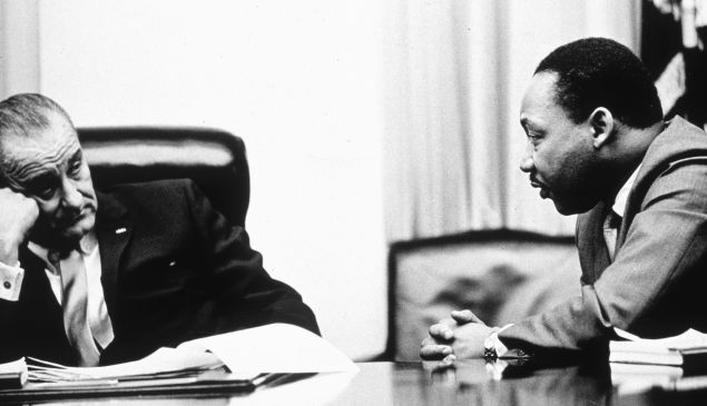 President Lyndon B Johnson (1908 - 1973) discusses the Voting Rights Act with civil rights campaigner Martin Luther King Jr. (1929 - 1968). (Photo by Hulton Archive/Getty Images)