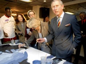 Britain's Prince Charles, Prince of Wales, right, and Duchess of Cornwall Camilla Parker-Bowles, center, help paint a mural inside of Heavenly Hall Church as part of a two-day trip to the U.S. January 27, 2007 in Philadelphia, Pennsylvania. (Photo by David Maialetti-Pool/Getty Images)