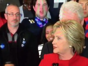 Sticker Guy at Iowa Clinton rally. (Photo: Screenshot via Twitter/LizzLocker)