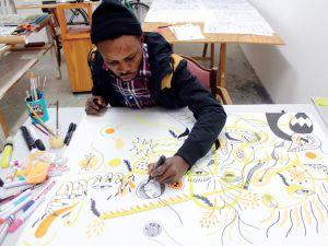 Artist Karo Akpokiere at work.