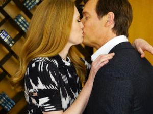 Mireille Enos and Peter Krause lip-lock on The Catch.
