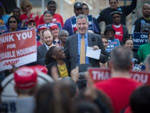 Mayor Bill de Blasio, New York City First Lady Chirlane McCray, United States Secretary of Housing and Urban Development Julián Castro and City Council Speaker Melissa Mark-Viverito lead a rally in Foley Square in Manhattan to celebrate the passage of the housing legislation.