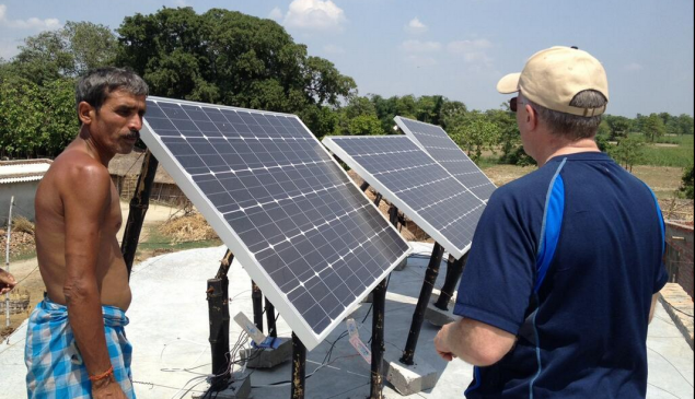 Brad Mattson, CEO of CEO of Siva Power, installs solar panels in an off-grid Indian village