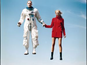A model and an astronaut in a surreal moment of suspension that was shot for (but never ran in) Vogue magazine in 1998.