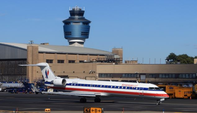 An American Airlines jet taxis on the runway at Laguardia Airport.
