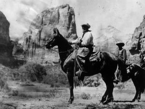 July 1923: 29th president of the United States Warren Gamaliel Harding (1865 - 1923) dressed as a cowboy for a presidential party in the West.