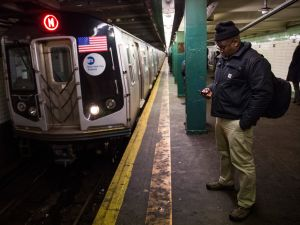 NEW YORK, NY - JANUARY 28: A man waits for a downtown M train at 14th Street Station on January 28, 2015 in New York City. The subway returned to its normal schedule today after being shut down at 11PM on Monday in preperation for a snowstorm and running on the weekend schedule yesterday. (Photo by Andrew Burton/Getty Images)
