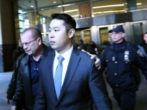 New York City police officer Peter Liang is escorted out of court.