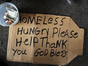 A homeless man's sign rests on the street on December 21, 2015 in New York City.